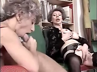 Granny in lace and stockings is secluded with a younger man